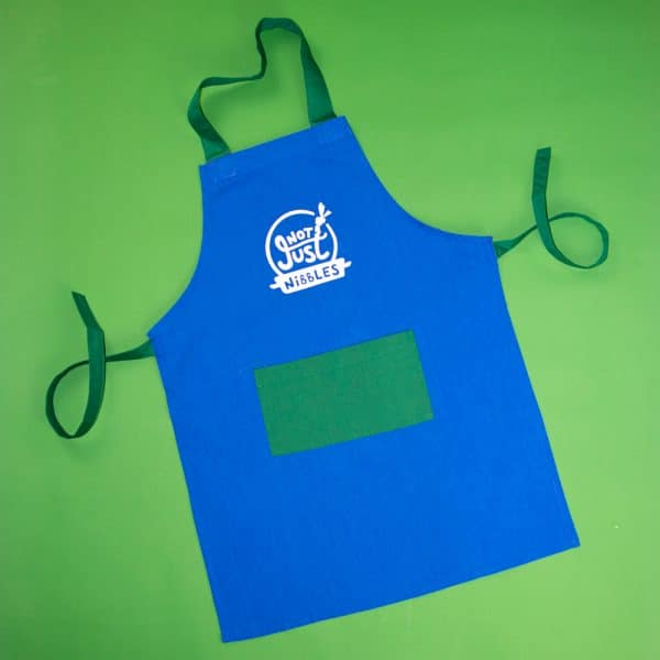 Blue with green pocket Not Just Nibbles apron