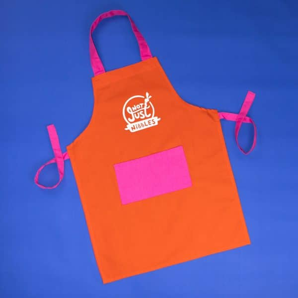 Orange with pink pocket Not Just Nibbles apron