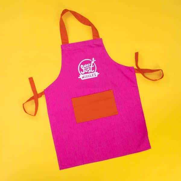 Pink with orange pocket Not Just Nibbles apron