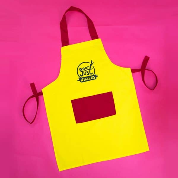 Yellow with red pocket Not Just Nibbles apron
